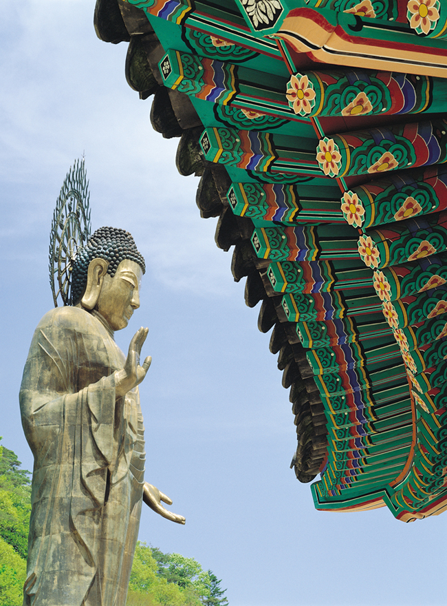 Dancheong roof and standing Buddha statue at Korean Temple