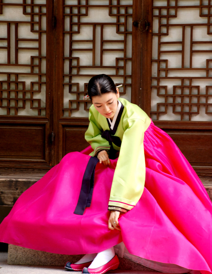 Woman wearing hanbok and flower shoes